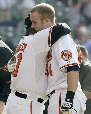 This is Nolan getting a hug from Dave Trembley after his first career walk-off home run. Quick fact: Nolans first career HR came off of Mariano Rivera! No other player can say that!