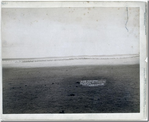 """Title: """"Grand review."""" U.S. troops after surrender of Indians at Pine Ridge Agency, S.D. Very distant view of a line of military men on horseback. 1891. Repository: Library of Congress Prints and Photographs Division Washington, D.C. 20540"""