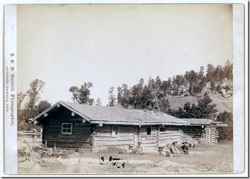 Title: The old cabin home Five men sitting in grass, in front of log cabin. [between 1887 and 1892] Repository: Library of Congress Prints and Photographs Division Washington, D.C. 20540