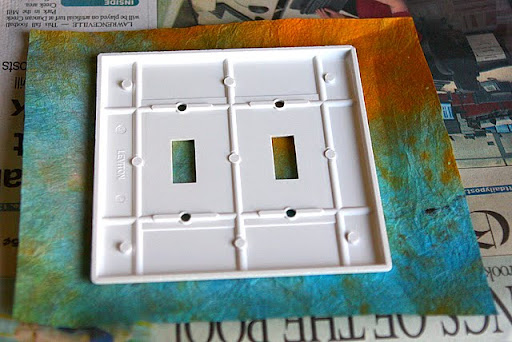 arrange cover on paper and leave room around the edges so you can fold the paper behind the cover - Decorative Switch Plates