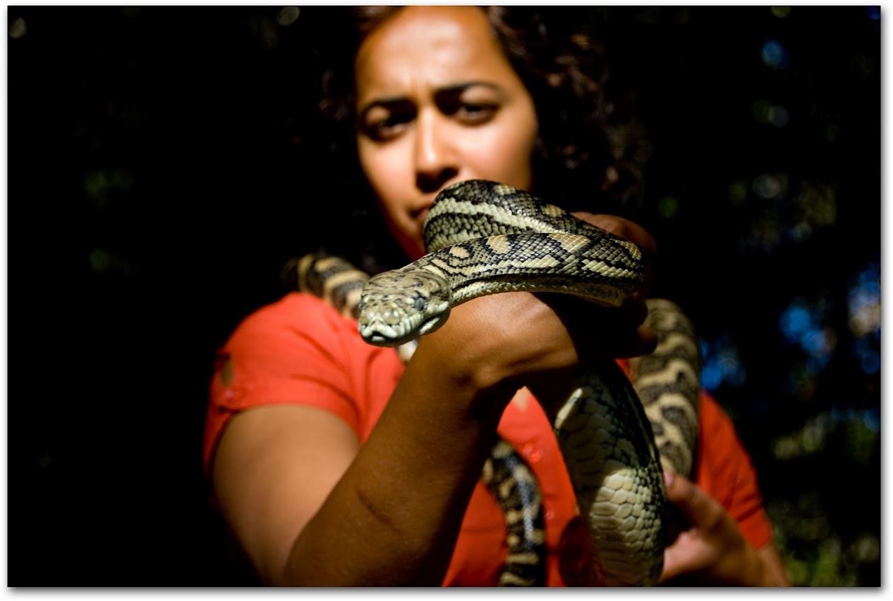 Akila holding a python