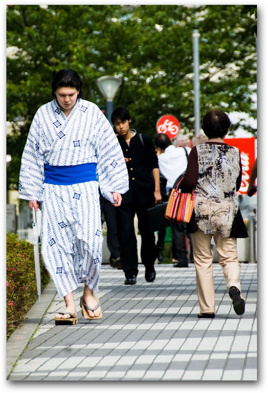 Sumo wrestler walking down street