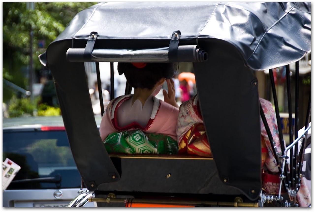 Geisha in rickshaw