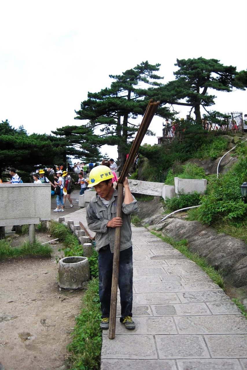 Guy carrying a pole
