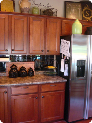 Cherry cabinets black tile