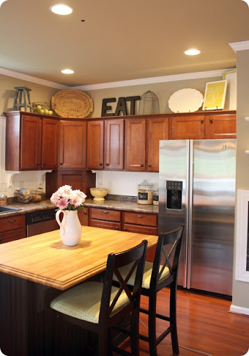 decorating above cabinets in kitchen