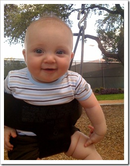 Reid's first swing at the park, 9-27-09