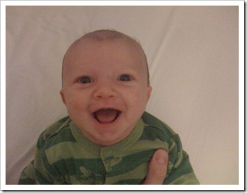 Baby Tate's BIG smile at one month old