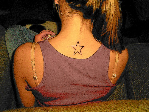 Simple star tattoo on a girl back neck Just another simple tattoo design