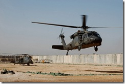 CAMP TAJI, Iraq – A Blackhawk and Apache attack helicopter from the 3rd and 4th Battalions, Combat Aviation Brigade, 4th Infantry Division, Multi-National Division – Baghdad, prepare to depart Camp Dolby recently on a combined air insertion operation six miles south of Baghdad. Soldiers from the CAB, the 1st Armored Div., and the Iraqi army conducted the operation as part of the ongoing air ground integration for MND-B aviators and Soldiers on the ground.