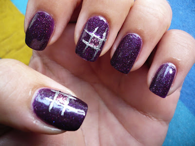 Nailart semplice: Purple glitter e incroci argento by Ale P1000674