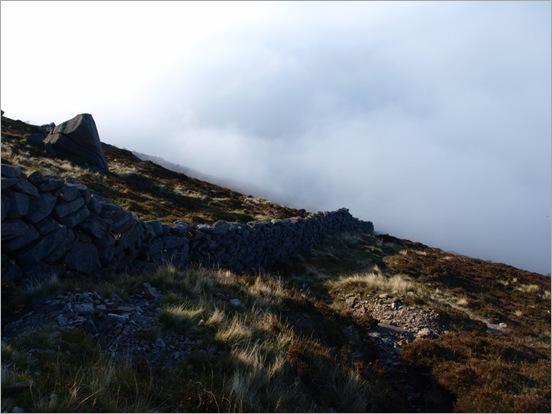 Descendin Binian through the clouds