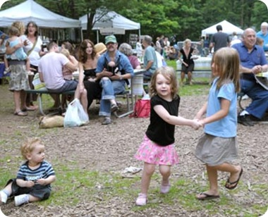 Children dancing to music of Uncle Rock at Woodstock Farm Festival.
