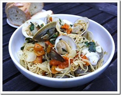 joseph fisheries little neck clams with taliaferro farms sungold tomatoes, basil, garlic and spaghetti