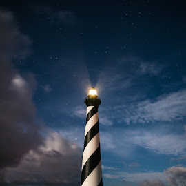 Cape Hatteras by the light of the moon by Stacy Abbott - Buildings & Architecture Statues & Monuments ( clouds, cape hatteras national seashore, night photography, stars, cape hatteras, lighthouse, night, light, supermoon, nightscape, Earth, Light, Landscapes, Views )