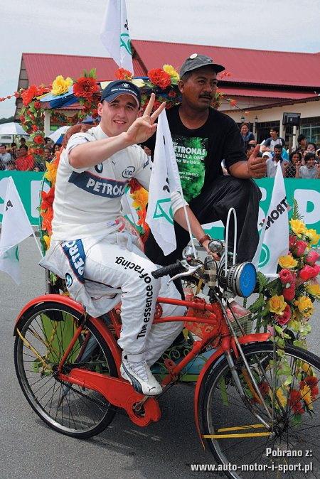 Роберт Кубица на велосипеде