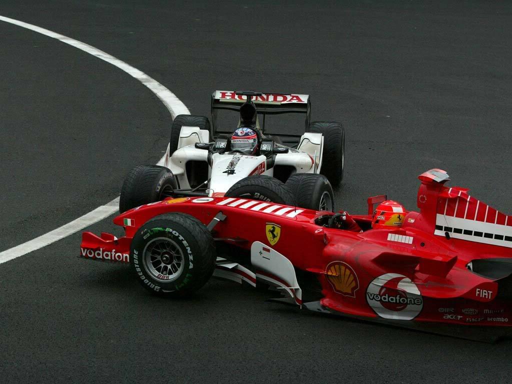 Такумо Сато врезается в Михаэля Шумахера на Гран-при Бельгии 2005