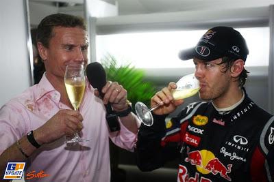 Дэвид Култхард и Себастьян Феттель пьют шампанское на Гран-при Австралии 2011