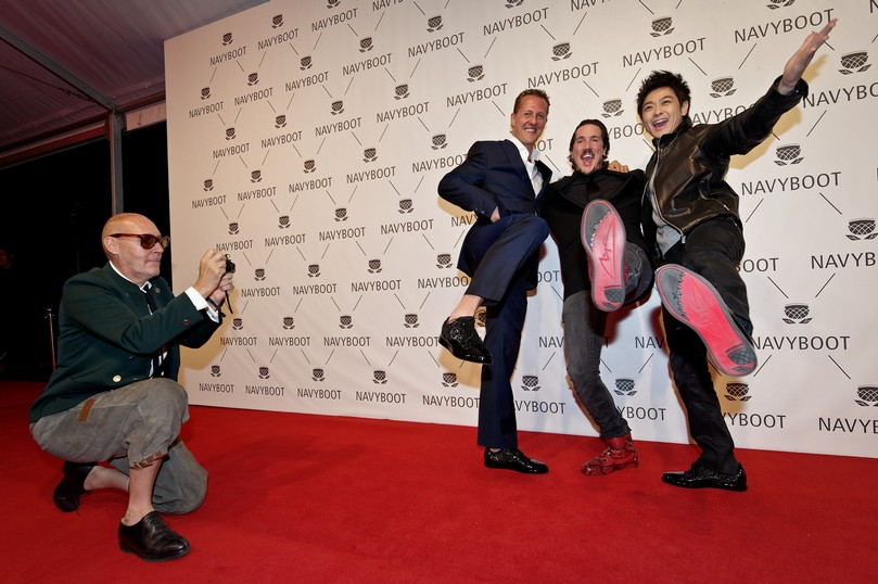 Photographer Michel Comte, Driver Michael Schumacher, Creative Director Navyboot Adrien J. Margelist and Jimmy Lin arrive at the red carpet for the Navyboot Msone Collection launch at MoCa