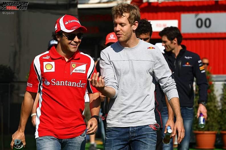 Фелипе Масса и Себастьян Феттель гуляют по паддоку на Гран-при Испании 2011