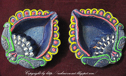 Dark blue diya handpainted by Reshmi