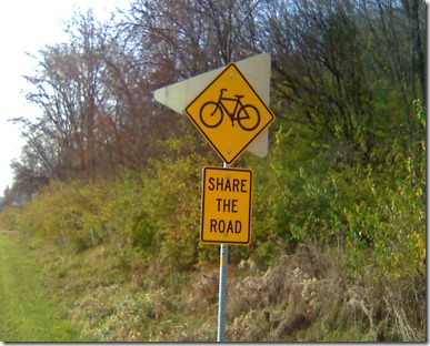 Share the road sign 1