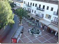 looking down into square in mijas quiet