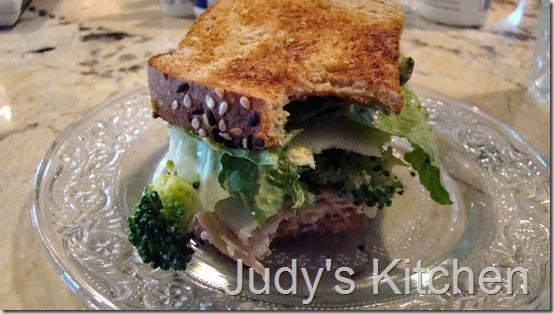 chicken cheese olive broccoli mayo mustard sandwich