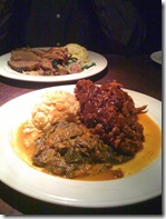 Pulled pork with collards foreground, smoked brisket in back