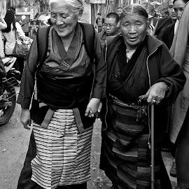 Elderly Tibetan Women Walking by Doug Hilson - People Street & Candids ( walking, black & white, tibetan, india, elderly, women )