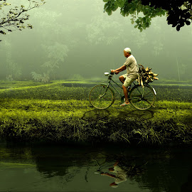 old man riding a bike by Herry West - People Portraits of Men ( ride, nature, green, old man, man )