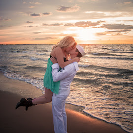 I miss you by Quisha McElroy - People Couples ( clouds, water, orange, skyline, uniform, colors, waves, beach, sailor, sun, couples, military, kiss, sky, sunset, couple, sunrise )