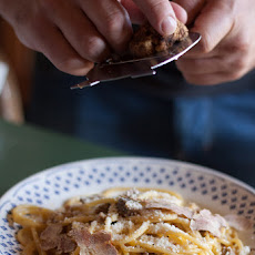 Unusual and luxurious carbonara with white truffle and duck breast