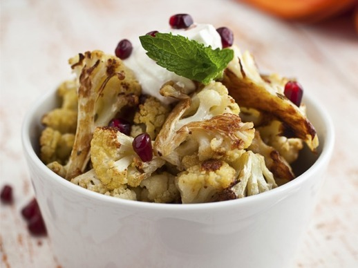 Cumin Seed Roasted Cauliflower with Salted Yogurt, Mint, and Pomegranate Seeds