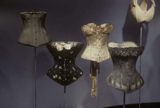 By emphasizing the sexually dimorphic curves of a woman's body, the corset functioned as a symbol of female beauty. Women with slender waists look younger and more feminine, because the waist-hip differential in young women tends to be 0.7 (waist seven-tenths as large as hips), in contrast to men's ratio of 0.85 or 0.9. After menopause, as fertility and estrogen levels decline, women's bodies approach the male ratio.