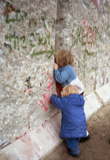 Brave New World? My two sons peer through holes hacked in Berlin Wall in December 1989. For them the Cold War is history.