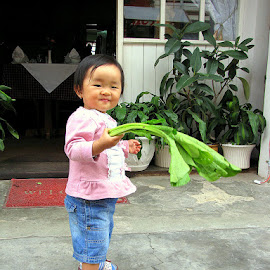 Vegetables are good for you by Leong Jeam Wong - Babies & Children Children Candids ( child, girl, green, play, vegetable, toddler, sword )