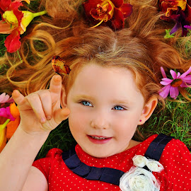 Butterfly Landing by Cheryl Korotky - Babies & Children Child Portraits ( butterfly, a heartbeat in time photography, flowers in hair, portrait idea for girls, portrait, red head, nature, lily, red hair, amazing faces, blue eyes, beautiful children, child model nevaeh, flowers )