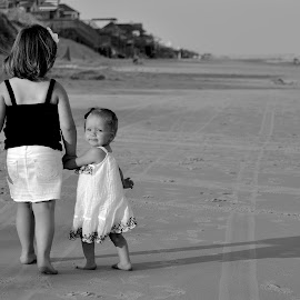 Where is she taking me? by Tony Moore - Babies & Children Toddlers ( look, girls, curious, nc, female, children, kids, beach, people, walk, coast )