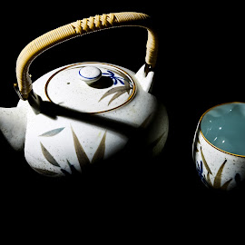 Serving Cha by Lawrence Burry - Artistic Objects Cups, Plates & Utensils ( bamboo handle, black background, directional lighting, ocha, low key, green tea, japanese tea pot, dramatic, ceramic dish, photo by l. burry, strong contast, hot tea )