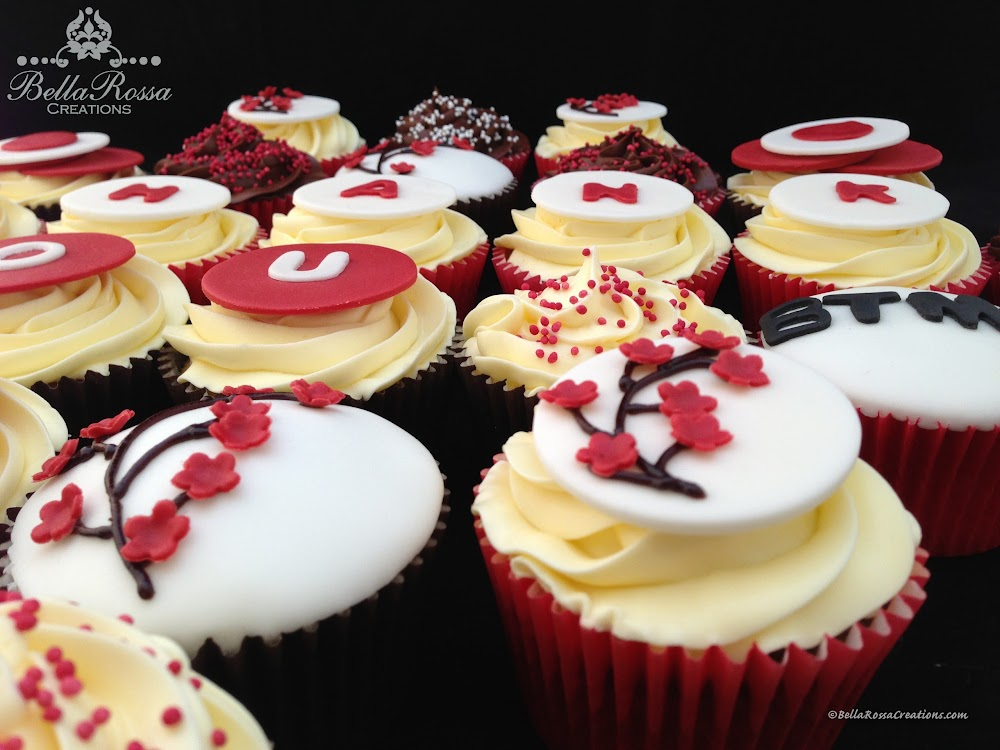 Red Velvet cupcakes decorated with company logo and Japanese cherry blossom, made for Bank of Tokyo-Mitsubishi UFJ, Ltd (BTMU).