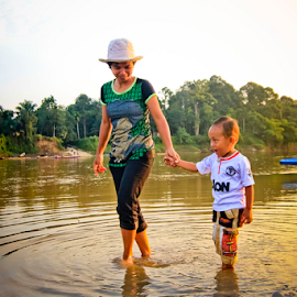 Mom and Kid by Heru  Nurjati - People Family ( mom kid river play boat sunset indonesia asian )