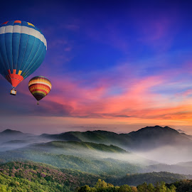 Doi Inthanon National park by Anek Suwannaphoom - Landscapes Travel ( inthanon, mountain, thailand, travel, sky, nature, tree, autumn, light, hill, wild, national, white, tourism, forest, sunlight, balloon, dawn, environment, season, fly, view, natural, range, peak, beauty, valley, landscape, hot air, tranquil, chiangmai, fresh, idyllic, asia, misty, green, beautiful, morning, foggy, blue, fog, color, sunset, outdoor, background, summer, cloud, sunrise, high, mist )