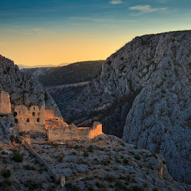 Ključica fortress by Nikola Belancic - Landscapes Travel ( europe, mountain, cultures, land, architecture, landscape, highland, nature, fortress, no people, dalmatia, orange, hill, dalmatian, cliff, croatia, canyon, fort, adriatic sea, history, mediterranean culture, blue, castle, sunrise, medieval )
