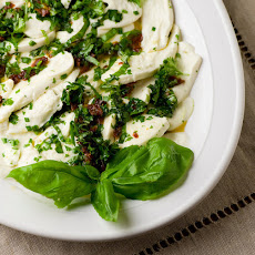 Marinated Mozzarella with Basil and Sun-Dried Tomatoes