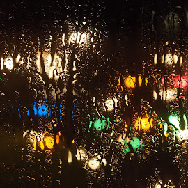 Storm on window. by Ólafur Ingi Ólafsson - Abstract Light Painting ( reflection, old, drop, reflections, collor, yellow, space, storm, reykjavík, cold, leafs, glass, light, black, rain, abstract, text, purple, green, christmas, waterdrops, fire, iceland, light painting, red, blue, drops, collorful )