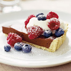 Chocolate Tart With Crème Fraîche & Raspberries