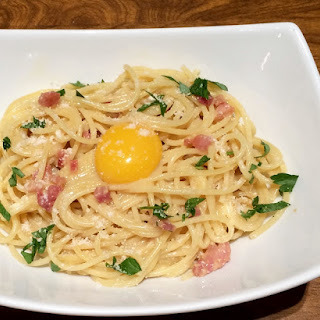 Spaghetti alla Carbonara Topped with a Yolk on Top