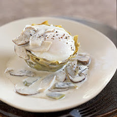 Poached Eggs on Artichoke Bottoms with White Truffle Cream and Mushrooms
