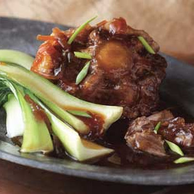 Braised Oxtails with Star Anise and Chinese Greens